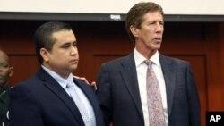 12일 미국 플로리다주 법정에서 재판을 받은 조지 짐머만(왼쪽)과 변호인 마크 오마라.