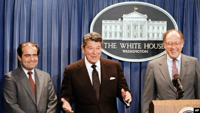 FILE - In this June 17, 1986 file photo, President Ronald Reagan announces the nomination of Antonin Scalia, left, to the Supreme Court. William Rehnquist is at right.