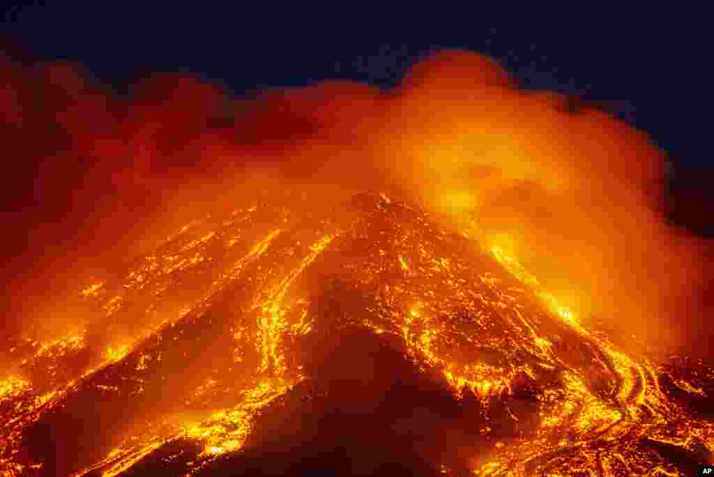 Lava gushes from the Mt Etna volcano near Catania, Sicily, Italy, Feb. 16, 2021.