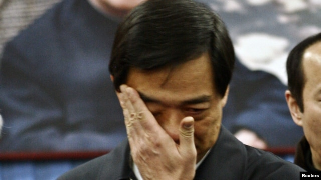 China's former Chongqing Municipality Communist Party Secretary Bo Xilai wipes  tears at a public mourning his father Bo Yibo, also a former top communist party official, in Beijing on January 17, 2007.