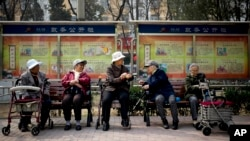 FILE - A group of elderly women rest in their wheelchairs at a residential compound in Beijing, China, March 31, 2016. By 2030, the number of elderly people in Asia is forecast to increase by 200 million.