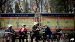 A group of elderly women rest in their wheelchairs at a residential compound in Beijing, China.