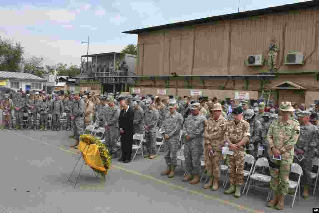 U.S. and NATO's forces observe a moment of silence during an event to mark the Memorial Day Ceremony at the U.S Camp Eggers base in Kabul, Afghanistan on May 26, 2008.