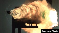 This photograph, taken from a high-speed video camera, shows a record-setting firing of an electromagnetic railgun at Naval Surface Warfare Center, Dahlgren, Virginia, Jan. 31, 2008. (Photo courtesy of U.S. Navy)