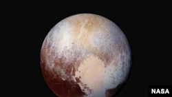 FILE - New Horizons scientists use enhanced color images to detect differences in the composition and texture of Pluto's surface, image released July 24, 2015.