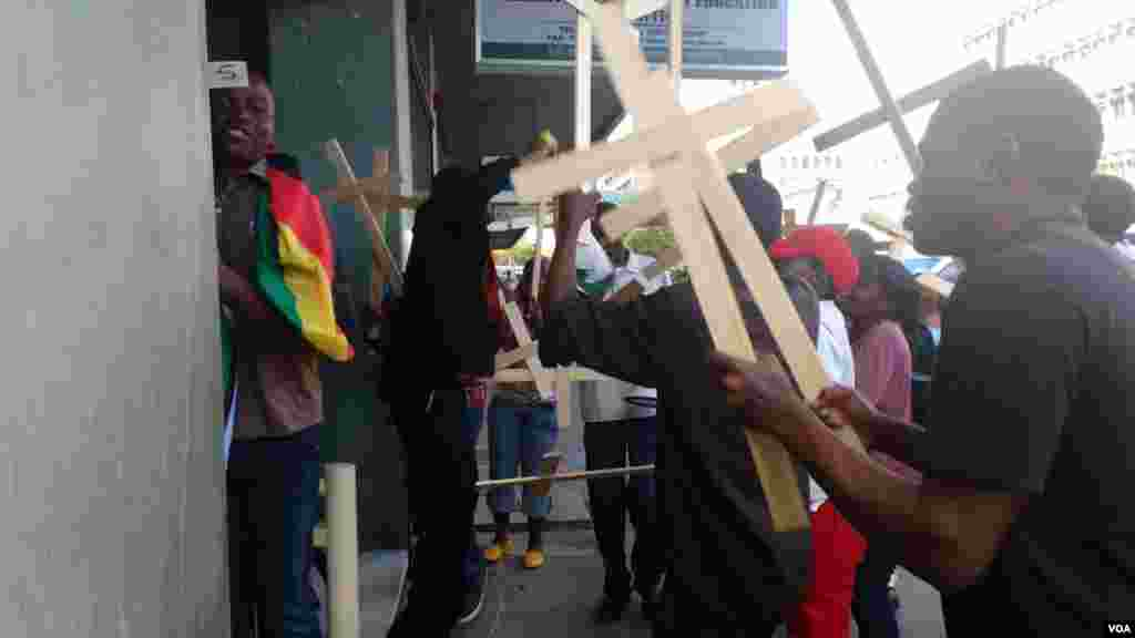 Members of various church groups take to the streets in Harare to express their dismay over the national pledge.