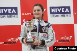 Fabienne Lanz on the winner's podium in Dubai, a few years ago. (Courtesy: Fabienne Lanz's collection)
