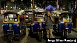 A tuk tuk driver waits for customers at Khaosan Road as tourism has decreased after coronavirus outbreak in Bangkok, Thailand March 12, 2020. REUTERS/Jorge Silva