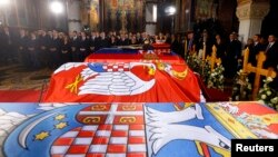 The coffins of Serbian King Petar II Karadjordjevic and his wife Queen Aleksandra, mother Queen Maria and brother Prince Andrej lie inside the St. George's Church on Oplenac Hill during their funeral in Topola, Serbia, May 26, 2013.