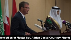 U.S. Secretary of Defense Ash Carter speaks with reporters during a joint news conference with Gulf Cooperation Council Secretary General Abdullatif bin Rashid Al Zayani, right, in Riyadh, Saudi Arabia, April 20, 2016.
