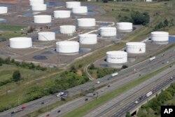 FILE - Traffic on I-95 passes Citgo oil storage tanks in Linden, N.J., Sept. 8, 2008.
