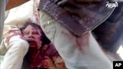20일 알 아라비야 텔레비전에 비친 가다피의 모습