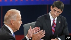 Vice President Joe Biden (l) and Republican vice presidential nominee Rep. Paul Ryan of Wisconsin participate in the vice presidential debate at Centre College, in Danville, Kentucky, Oct. 11, 2012.