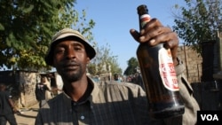 On a Friday evening in Diepsloot, the streets are filled with men drinking. (D. Taylor/VOA)