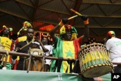 Senegal's supporters drum during an AfroBasket match between Senegal against South Africa at Marius Ndiaye stadium in Dakar, Senegal, Sept. 8, 2017.