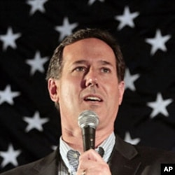 U.S. Republican presidential candidate Rick Santorum speaks to supporters at Savre Lanes in Menasha, Wisconsin, April 2, 2012