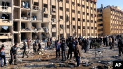 In this photo released by the Syrian official news agency SANA, Syrian people gather at the site after an explosion hit a university in Aleppo, Syria, Jan. 15, 2013.