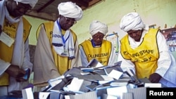 Southern Sudan Referendum Commission staff members prepare the official counting of votes on South Sudanese independence. The Civilian Response Corps supported U.S. efforts to help Sudan carry out its referendum on independence.