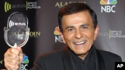 FILE - Casey Kasem poses for photographers after receiving the Radio Icon award during The 2003 Radio Music Awards in Las Vegas. Kasem died at the age of 82, June 15, 2014.