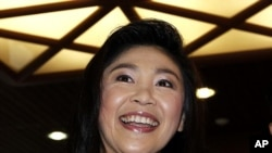 Prime Minister-elect Yingluck Shinawatra of the Puea Thai Party addresses reporters at her party's headquarters in Bangkok, July 19, 2011.