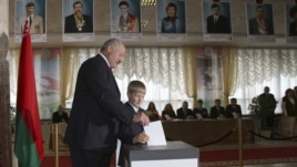 Belarusian President Alexander Lukashenko with his youngest son Nikolai casts his ballot at a polling station during parliamentary elections in Minsk, Belarus, Sunday, Sept. 23, 2012.