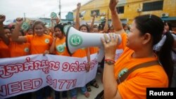 FILE: Garment workers shout during a protest calling for higher wages in Phnom Penh September 17, 2014.