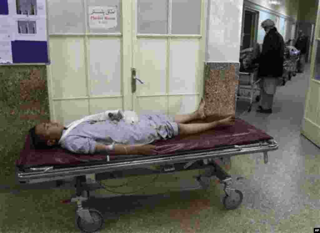 An Afghan boy, who was injured in a suicide attack during a Muharram procession, lies on a bed at a hospital in Kabul, Afghanistan, Tuesday, Dec. 6, 2011. A suicide bomber struck a crowd of Shiite worshippers marking a holy day Tuesday in the Afghan capit