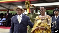 Uganda's long-time president Yoweri Museveni, 71, left, and his wife Janet Museveni, right, attend his inauguration ceremony in the capital Kampala, May 12, 2016.