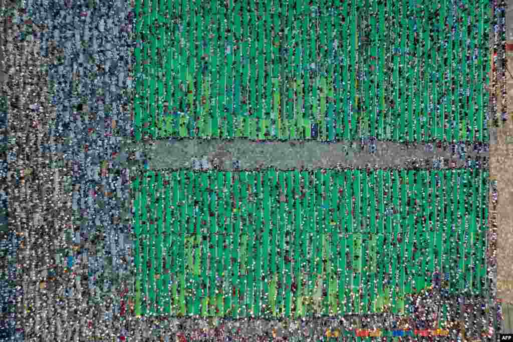 This aerial view shows Muslims attending the Eid Al-Adha prayer at Skenderbej Square in Tirana, Albania.