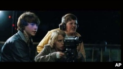 Middle schoolers filming a movie witness a train derailment that sets the plot of 'Super 8' into high gear, June 2011