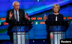 U.S. Senator Bernie Sanders debates former Secretary of State Hillary Clinton during the first official Democratic candidates debate of the 2016 presidential campaign in Las Vegas, Oct. 13, 2015.