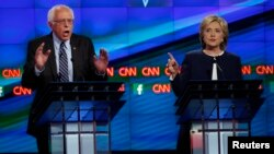 U.S. Senator Bernie Sanders debates former Secretary of State Hillary Clinton during the Democratic presidential candidates debate in Las Vegas, Oct. 13, 2015.
