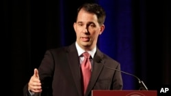 FILE - Wisconsin Gov. Scott Walker, shown in June, becomes the 15th candidate to enter the crowded Republican field for president.