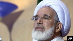 FILE- Iran's former parliament speaker, opposition cleric Mehdi Karroubi.