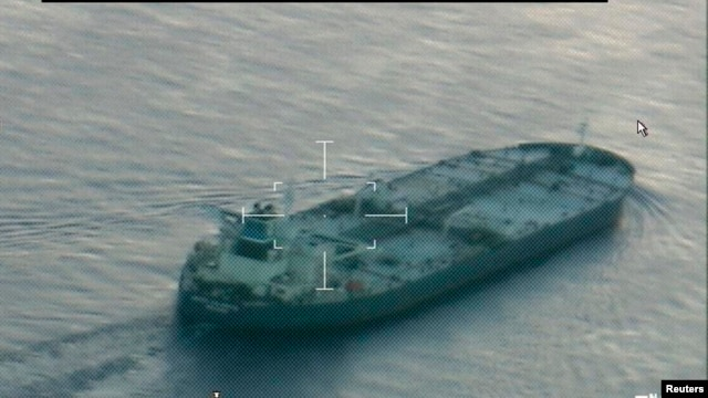 A still image from video taken by a U.S. Coast Guard HC-144 Ocean Sentry aircraft shows the oil tanker United Kalavyrta (also known as the United Kalavrvta), which is carrying a cargo of Kurdish crude oil, approaching Galveston, Texas, July 25, 2014.