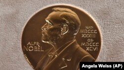 FILE - A Tuesday, Dec. 8, 2020 file photo of a Nobel medal displayed during a ceremony in New York.