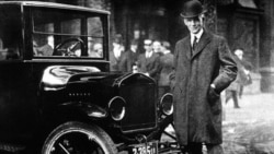 Henry Ford with a Model T.