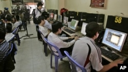 FILE - Students surf web at an Internet cafe in Hanoi, Vietnam, March 31, 2010. (AP Photo/Tran Van Minh)