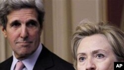 Secretary of State Hillary Rodham Clinton, right, accompanied by Senate Foreign Relations Committee Chairman Sen. John Kerry, D-Mass., left, talks about the START Treaty, on Capitol Hill in Washington, 17 Nov 2010
