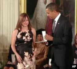 Susan Retik Ger receives the 2010 Presidential Citizens Medal, the nation's second highest civilian award, from President Barack Obama.