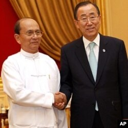 Burma's President Thein Sein (L) and United Nations Secretary-General Ban Ki-moon shake hands before their meeting.