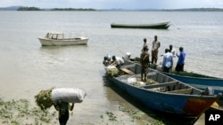 FILE - Boats on Lake Victoria in the fishing village of Ggaba, Uganda, Nov. 3, 2006. Tests have confirmed that avian flu is responsible for the mass deaths of wild birds on the shores of Lake Victoria in Uganda.