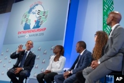 FILE - Then-President Barack Obama, left, takes part in a panel discussion at the Global Entrepreneurship Summit at the United Nations Compound, July 25, 2015, in Nairobi.