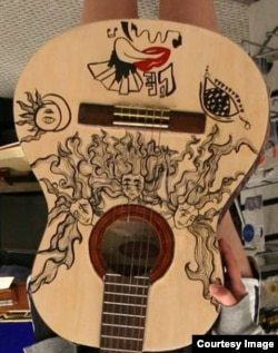 Three Sisters Heads Guitar by Carla Araneda (Courtesy Victor Litz Music Center)