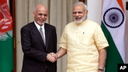 FILE - Indian Prime Minister Narendra Modi (right) shakes hands with Afghan President Ashraf Ghani before a meeting in New Delhi, India, Sept. 14, 2016.
