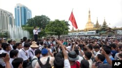 In Myanmar, also known as Burma, a student activist speaks during a protest of constitutional amendments, downtown Yangon, June 30, 2015.