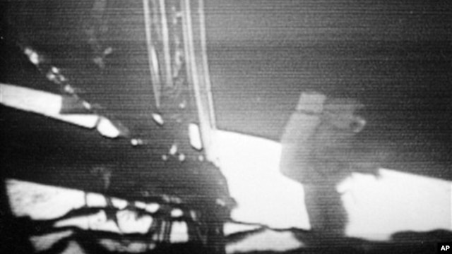 Apollo 11 commander Neil Armstrong walks slowly away from the lunar module to explore the surface of the moon on July 20, 1969