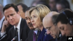 U.S. Secretary of State Hillary Clinton (C) speaks during a conference at the Foreign & Commonwealth Office in London March 29, 2011. More than 40 governments and international bodies gathered in London on Tuesday to plan for a Libya without Muammar Gadda