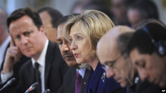 U.S. Secretary of State Hillary Clinton (center) speaks during a conference at the Foreign & Commonwealth Office in London, March 29, 2011