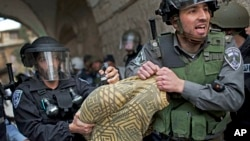 A Palestinian man is detained by Israeli security forces in Jerusalem's Old City, March 8, 2013.